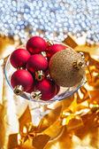 Christmas balls in martini wineglass — Stock Photo