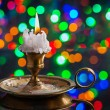 Old candle in vintage candlestick — Stock Photo #60134781