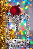 Christmas toys in wineglass — Stock Photo