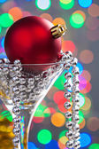 Christmas bauble in wineglass — Stock Photo
