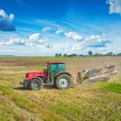 Agricultural view tractor with plough — Stock Photo #60346275