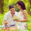 Couple sitting on grass — Stock Photo #60346553
