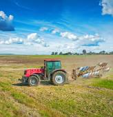 Agricultural view tractor with plough — Stock Photo