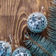Disco balls and branch of pinetree — Stock Photo #61177261