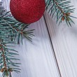 Christmas ball and pinetree branch — Stock Photo #61177287