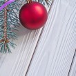 Christmas ball and pinetree branch — Stock Photo #61177293