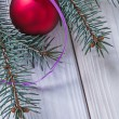 Christmas ball and pinetree branch — Stock Photo #61177353