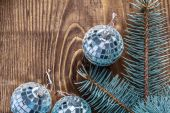 Disco balls and branch of pinetree — Stock Photo