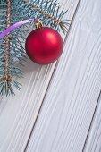 Christmas ball and pinetree branch — Stock Photo