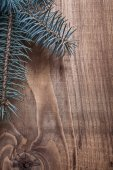 Pinetree branch on old wooden board — Stock Photo