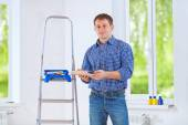 Homeowner holding color palette — Stock Photo