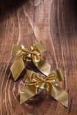 Golden bows with small bells — Stock Photo