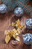 Golden christmas bows and disco balls — Stock Photo