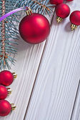 Red christmas balls and pinetree branch — Stock Photo