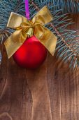 Red christmas bauble and gold bow — Stock Photo