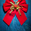 Christmas bow with gold ribbon — Stock Photo #61464979
