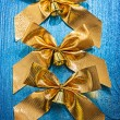Three golden bows with little bells — Stock Photo #61465037