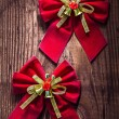 Two red christmas bows — Stock Photo #61465111