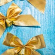 Three golden bows with little bells — Stock Photo #61465125
