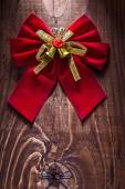 Beautiful red christmas bow with gold ribbon — Stock Photo