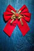 Christmas bow with gold ribbon — Stock fotografie