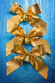 Three golden bows with little bells — Stock fotografie