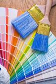 Color palette and paintbrushes — Stock Photo