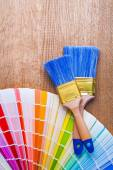 Two paintbrushes on color palette — Stock Photo
