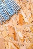Stack of nails on plywood — Stock Photo