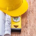 Blueprints and construction spirit level — Stock Photo #63922225