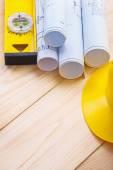 Blueprints with yellow helmet — Stock Photo