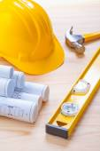 Blueprints with helmet and hammer — Stock Photo