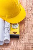 Blueprints and construction spirit level — Stock Photo