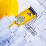 Construction level, helmet, blueprints — Stock Photo #64808045