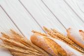 Baguettes and ears of wheat — Stock Photo