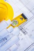 Construction level, helmet, blueprints — Stock Photo
