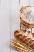 Loaf of bread, wheat ears — Stock Photo