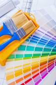 Paintbrushes  on color palette — Stock Photo