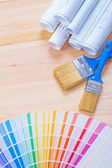 Color palette with paintbrushes — Stock Photo