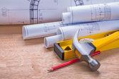 Blueprints, level, hammer — Stock Photo
