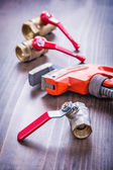 Adjustable wrench and plumbing fixtures — Stock Photo