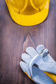 Claw hammer, glove and helmet — Stock Photo