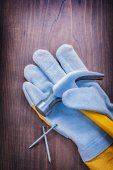 Claw hammer on glove and nails — Stock Photo