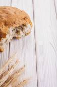Sliced bread and ears of wheat — Stock Photo