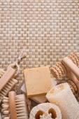 Massager, bar soap, loofah and nail brush — Stock Photo
