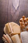 Wooden massager nail brush loofah bar soap wisp on vintage woode — Stock Photo