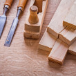 Stack of wooden planks chisels — Stock Photo #68237275