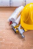 Blueprints, level, hammer and helmet — Stock Photo