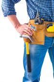 Carpenter holding hand on toolbelt — Stock Photo