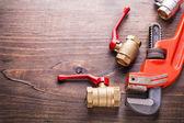 Plumbers fixtures monkey wrench — ストック写真